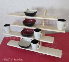 """4-Shelf 30"""" Wide Display Stand: Assembled: 30.0""""W x 20.5""""H x 17.0""""D Shelves: 30.0""""W x 4.5""""D x 0.75""""H Overlap: 1.0""""D Tooth Bite: 0.75""""D Shelf to next: 4.75""""H Thru: 4.0""""H Table-1st shelf: 2.75"""" Flat Weight: 8.125 lbs Assembles in less than 30 seconds with ease. See our video showing"""