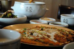 Dongnae Pajeon(Welsh-onion pancake)! It's Korean traditional pancakes made of welsh-onion and lots of seafoods. It is very famous in Busan, Korea.