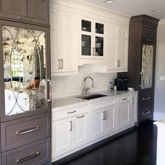 Kitchen Freezer and Fridge with mirrored cabinets.  A. Perry Homes.