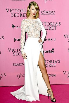 Taylor Swift flaunted her long legs in a white dress at the 2014 #VSFashionshow afterparty in London.