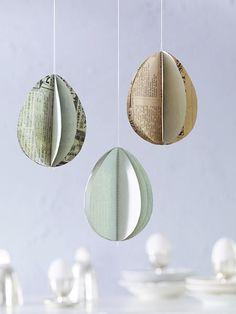 Papiereier - schnell, schick und eine willkommene Abwechslung zu den bunten Plastikeiern. Einfach Papier in Eierform zuschneiden und mit Nadel und Faden zusammennähen.