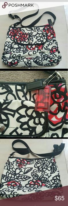 """Coach Poppy Daisy Graffiti Floral Purse Coach shoulder bag/or crossbody.  Cream base with hot pink/red/black floral print.  Trimmed in black.  Light stains on front exterior pocket shown in picture 2.  Smoke/pet free home.  Dimensions 12""""W x 9.5L x 3""""D  Thanks for looking. Coach Bags Crossbody Bags"""