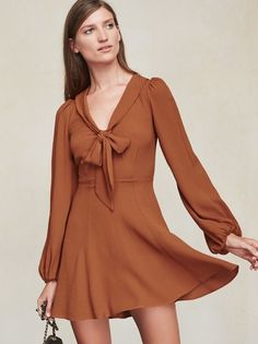 THIS ITEM WILL SHIP AUGUST 25th. The Rosetta Dress makes us think of Brigitte Bardot strutting around in the 70s and looking super French. https://www.thereformation.com/products/rosetta-dress-cognac?utm_source=pinterest&utm_medium=organic&utm_campaign=PinterestOwnedPins