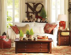 Love the NOEL letters, and the tree cutouts on the coffee table