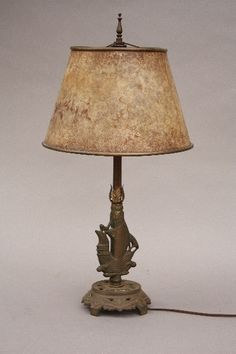 "Circa 1920's table lamp with galleon motif and original mica shade 25"" H x 12"" W"