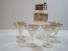 This gold vintage drink set would be excuse enough for parties all year -   Vintage Art Deco Cocktail Mixer Martini Shaker and by cityfleas
