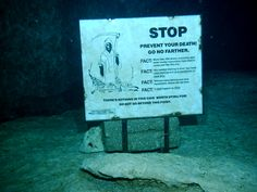 Cave diving warning sign, Chac Mool cenote, Tulum Mexico.
