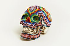 Our Exquisite Corpse worked with the Huichol people of Mexico to create these beaded, one-of-a-kind skulls that showcase immense artisan talent – drawing influence from ancestor spirits and the four principle deities – deer, corn, peyote, and the eagle.