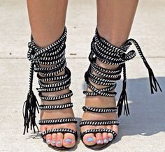 "Ultra chic & stylish high heels Strappy rope design Gladiator style Fringe detail  Heel Height: 3.94"" Width: Medium (B, M) Style: Boho/Bohemian/Gypsy Material: Leather Available Colors: Black/White  Shipping: Ships within 1-7 business days. Delivery for this item takes 7-20 business..."