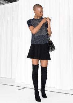 Fancy knit sweater featuring short sleeves, glittering stripes, and a slight peplum silhouette.