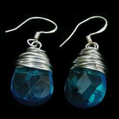 Add a touch of color to your outfit with handmade jewelry from China. These earrings feature facetted blue glass raindrops wrapped with silver wire. $15.99