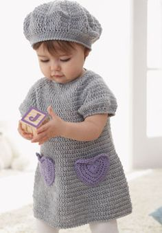 Sweet crochet dress with accent heart pockets and matching beret for ages 6 to 18 months.