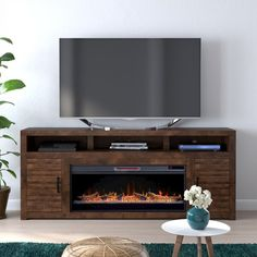 """Gather the family around, put the fireplace on, and enjoy an evening around this TV Stand for TVs up to 88"""" with Electric Fireplace. Infusing modern and rustic charm, it features a golden glow of rich Whiskey color, notched panels in each door and a large electric fireplace with remote to control flame intensity, LED color options, automatic timer function, and heat settings as well. Built in the U.S.A. it has good old' American ingenuity and know-how to combine utility with form and function. Grand Tv, Large Electric Fireplace, Fireplace Console, Console Tv, Tv Stand With Fireplace, Traditional Cabinets, Wood Molding, Coffee Table With Storage, Tv Stands"""