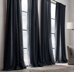 Indigo drapes in neutral bedroom.  11 Celebrity Secrets to Making Your Home Look More Luxurious via @MyDomaine