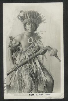 Fijian Warrior in gala dress with totokia club.