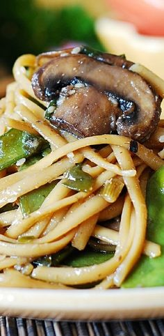Spicy Asian noodles and mushrooms, with snow peas