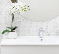 The stylish and modern design of the Toto Rei Basin Mixer combined with the thin edge top of the vanity and large round mirror, turn this bathroom a contemporary space.  Image from Signature Homes - Christchurch Showhome