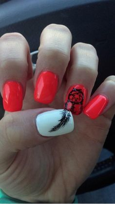Orange nails with feather and dream catcher
