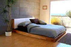 une chambre à coucher zen élégante avec un palmier et donnant sur le jardin