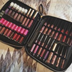 This looks like an awesome way to keep your liquid lippies organized and travel safe.