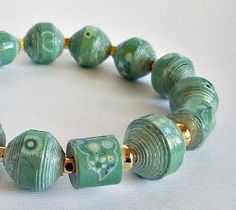 The possibilities with paper beads in crafts and making jewelry are endless. It … The possibilities with paper beads in crafts and making jewelry are endless. It is a great way to recycle used left over junk mail, newspa… Make Paper Beads, Paper Bead Jewelry, Quilling Jewelry, Bead Jewellery, Fabric Jewelry, How To Make Beads, Beaded Jewelry, Beaded Bracelets, Paper Bracelet