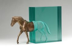 Bronze and Glass Horse Appears to Exit a Cascade of Water - My Modern Met