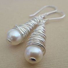 Like a whirlpool! or Tornado? These earrings are handmade from head to toe using sterling silver and gorgeous freshwater pearls