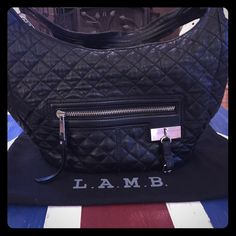 L.A.M.B. quilted shoulder bag Gently used but in good condition. She is looking for a new home! Dustbag is included. Front zipper compartment plus one inside as well as 2 small pockets. Measures 11 X 15. Drop is about 6 1/2-7 in. L.A.M.B. Bags Shoulder Bags