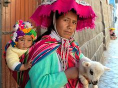 """Peruvian woman with child and sheep - Pat Cordeiro. The photo of the """"mama"""" and her baby was taken in one of the streets in Cusco Peru."""