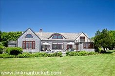 Nantucket - 5 Beacon Lane - Private waterfront estate with stunning views of Sesachacha Pond, Sankaty Lighthouse and the Atlantic ocean on the horizon.This beautifully manicured private estate is located through the tunnel hedge off of Quidnet Road. Spacious rooms with large windows and gorgeous water views abound. The oversized decks are perfect for sun bathing, reading and taking in all of the beauty that this enchanting property has to offer!