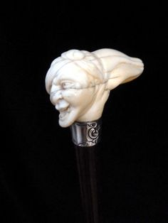 Snake wood cane with silver collar and ivory handle (England)