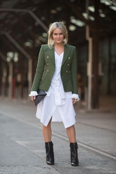 Add a structured blazer and heavy black booties to extend the wear of a white cotton shirtdress.