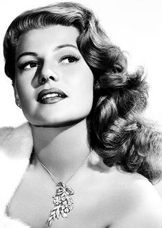 rita hayworth - If you want to wear your hair down and curled, it better look like this - Lots of volume, away from face - sprayed down hard. Dancers will need a more secure hair do.