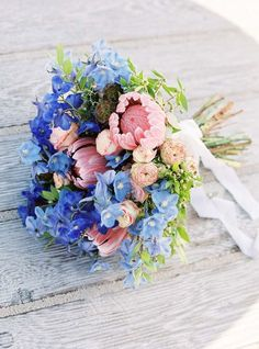 Wedding bouquet with serenity blue and blush pink flowers.