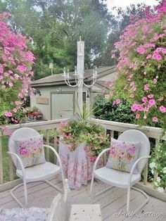 Cute ideas for decorating the deck: coordinate pillows with colors of flowers. I love the chandelier on the corner post for lighting.