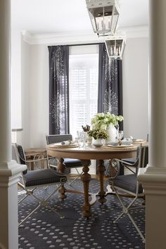Sarah Richardson Design  Cool gray walls paint color, dining table from Rose Antiques, antique dining chairs with navy blue striped cushions, navy blue rug, white lanterns and blue curtains.   Para PaintsMennonite Grey