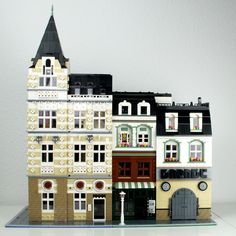 This is just another shot of two of my LEGO modular buildings: the Main Post Office and the Mom and Pop store. - by Palixa And The Bricks