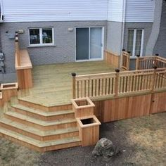 I like the planter boxes going down along side the stairs.