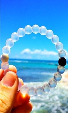 Livelokai bracelet. Injected in the black bead is mud from the Dead Sea and injected in the white bead is water from Mt Everest. The highest and lowest points on Earth, so whether you're on top of the world or down on your luck, Lokai reminds you to stay humble, hopeful, and to always move forward. :)