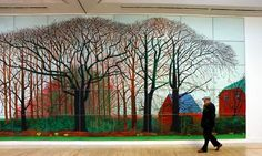 David Hockney at Tate Britain with one of the photographic copies flanking his painting Bigger Trees Near Warter (2007).  Photograph: Graham...