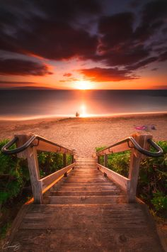 The soft orange sunset over the ocean beckons the viewer of this photograph to the horizon. Awesome water scene!