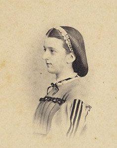 CDV Young lady, yoked, pleated bodice with ribon trim.  Beribboned (box pleated?)hairnet.  Etsy.