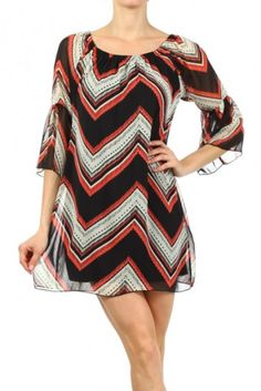 Zig zag printed, semi-sheer scoop neck shift dress with half bell sleeves and inner lining.