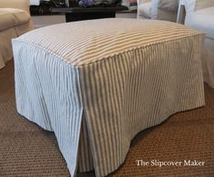 Ticking ottoman slipcover in black and natural.  Stitched down corners replace boxing for a clean, simple look.