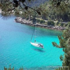 Saliara beach, Thassos, Greece The water is so clear it looks like the boat is floating on air...