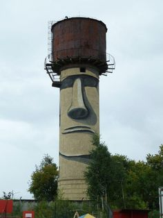 An unknown artist transformed this water tower in Ekaterinburg, Russia, into a Moai of Easter Island.