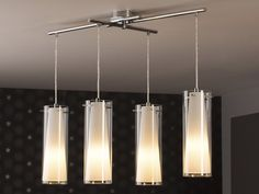 : Suspension 4 lumières Pinto Matières : Acier Verre Finition : chrome Dimensions : Hauteur : 110 cm Longueur : 90.5 cm Largeur : 36 cm Fonctionne avec 4 ampoules culot ...