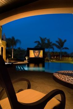 Sweet! Giant TV screen by the pool.