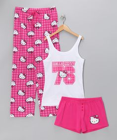 Hello Kitty isn't just for kids—she also makes the perfect BFF well into adulthood. With its happy pink houndstooth print, this cute and comfy set will conjure up all sorts of sweet childhood memories after a long day of being a grown-up. The perfect gift for any slumbering sweetie, this set comes gift-wrapped, tied with a pink satin bow and a gift tag attached.Includes tee, shorts and pant...