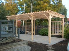 White cedar pergola with back lattice panels.  Supplied and installed by Lanark Cedar
